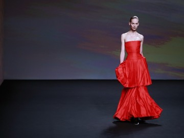 A model presents a creation by Belgian designer Raf Simons as part of his Haute Couture Fall Winter 2013/2014 fashion collection for French fashion house Christian Dior in Paris